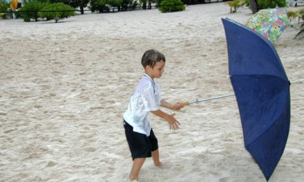 Boy Learning to Use Umbrella